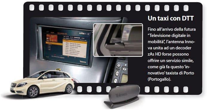 """Un taxi con DTT - Fino all'arrivo della futura """"Televisione digitale in mobilità"""", l'antenna Innova unita ad un decoder zAs HD forse possono offrire un servizio simile, come già fa questo 'innovativo' taxista di Porto (Portogallo)."""